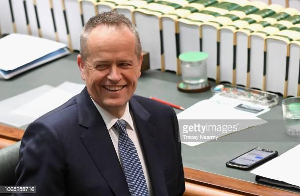 Opposition Leader Bill Shorten laughs as he listens to Prime Minister Scott Morrison speak during question time at Parliament House on November 26...