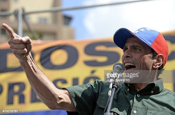 Opposition leader Henrique Capriles Radonski talks during a protest against the government of Venezuelan President Nicolas Maduro in Caracas on...