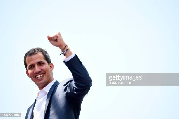 Opposition leader Juan Guaido gestures at thousands of supporters in Caracas on February 2 2019 Tens of thousands of protesters were set to pour onto...