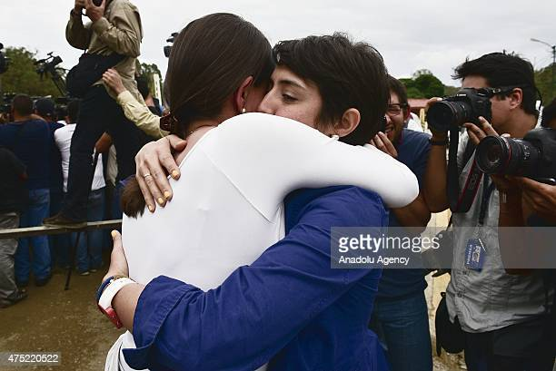 Opposition Leader Maria Corina Machado hugs Patricia de Ceballos wife of imprisoned opposition mayor Daniel Ceballos while attempting to visit the...