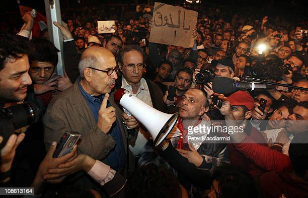 Opposition leader Mohamed ElBaradei waves to supporters in Tahrir Square on January 30, 2011 in Cairo, Egypt. Cairo remained in a state of flux and...