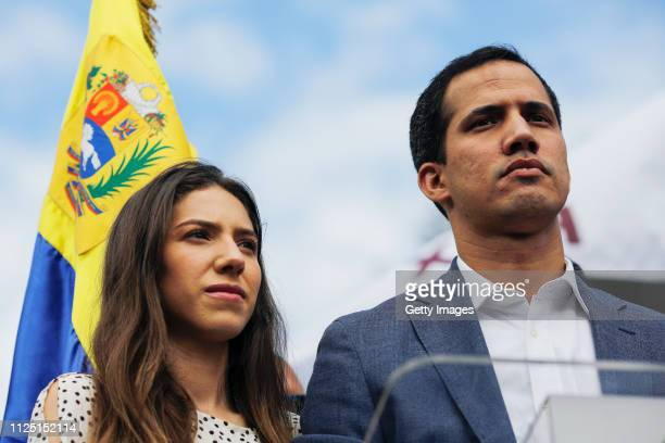 Opposition leader of Venezuela Juan Guaidó delivers a speech next to his wife Fabiana Rosales during a demonstration on January 26 2019 in Caracas...
