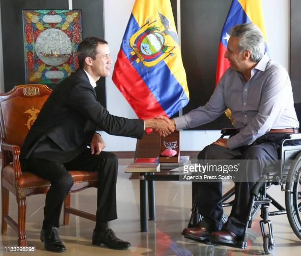 Opposition leader of Venezuela Juan Guaido shakes hands with President of Ecuador Lenín Moreno as part of a tour around Latin America on March 1 2019...