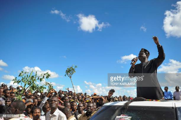 TOPSHOT Opposition leader Raila Odinga gives an address to his supporters during demonstrations in the Umoja subururb of Nairobi on November 28...