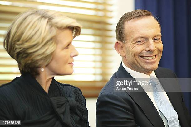 Opposition Leader Tony Abbott and Deputy Leader Julie Bishop listen to Nationals Leader Warren Truss speak to Coalition MPs in the party room on June...