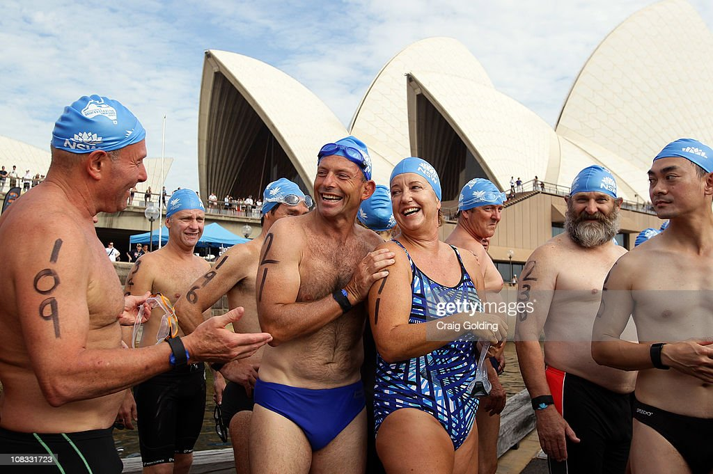 Opposition leader Tony Abbott (5th R), chats with other swimmers before the start of the Body Science Great Australian Swim Series at the Sydney Harbour on January 26, 2011 in Sydney, Australia. The inaugural ocean swim event brings people of all ages together to compete in distances between 300 metres and 2.5 kilometres against the backdrop of the Sydney Harbour.
