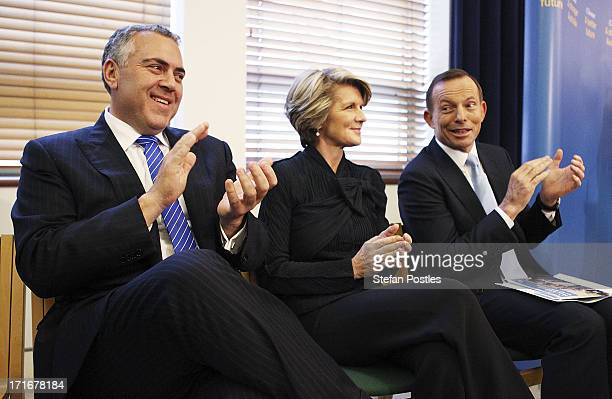 Opposition Leader Tony Abbott Deputy Leader Julie Bishop and Shadow Treasurer Joe Hockey listen to Nationals Leader Warren Truss speak to Coalition...