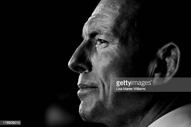 Opposition Leader Tony Abbott faces questions from the media during a visit to Rocky's Own Transport Company on August 31, 2013 in Rockhampton,...
