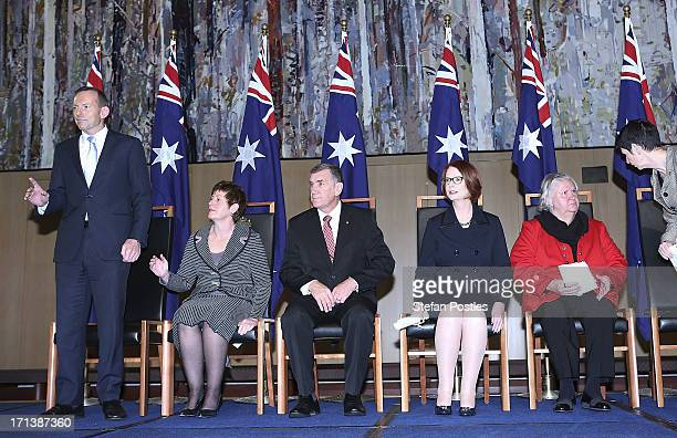 Opposition leader Tony Abbott is the last one standing on stage at the APH 25th Anniversary Morning Tea on June 24 2013 in Canberra Australia...