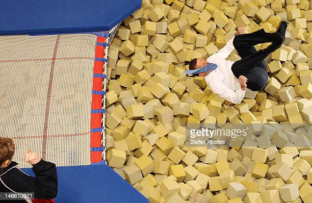 Opposition leader Tony Abbott jumps into the foam pit during an Australian Olympic Gymnastics Team Announcement at AIS on June 21, 2012 in Canberra,...