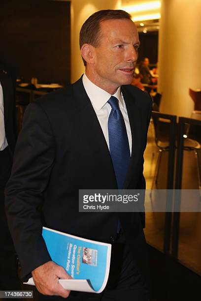 Opposition Leader Tony Abbott leaves a media conference after he Unveiled the Coalition Border Protection Policy at the Hilton Hotel on July 25 2013...