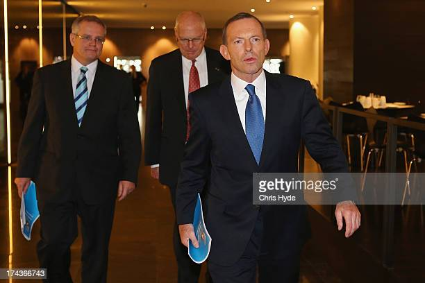 Opposition Leader Tony Abbott Leaves the media conference after unveiling the Coalition Border Protection Policy with Shadow Minister for Immigration...