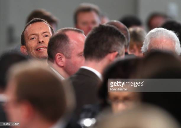 Opposition leader Tony Abbott looks on from his table during the Australian Liberal Party's final week of campaigning ahead of this weekend's Federal...
