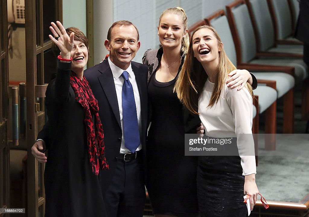 Opposition leader, Tony Abbott poses for photographers with his family after delivering his budget reply in the House of Representatives at Parliament House on May 16, 2013 in Canberra, Australia. Abbott claims a Coalition government will abolish the carbon tax if elected on September 14. The government unveiled the 2013/2014 federal budget on Tuesday, revealing an 19.4AUD billion deficit with plans to reach surplus by 2016/2017 should the Labor party be re-elected this September.