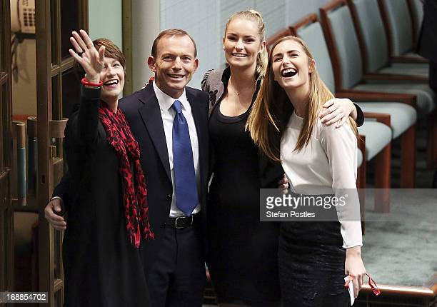 Opposition leader Tony Abbott poses for photographers with his family after delivering his budget reply in the House of Representatives at Parliament...