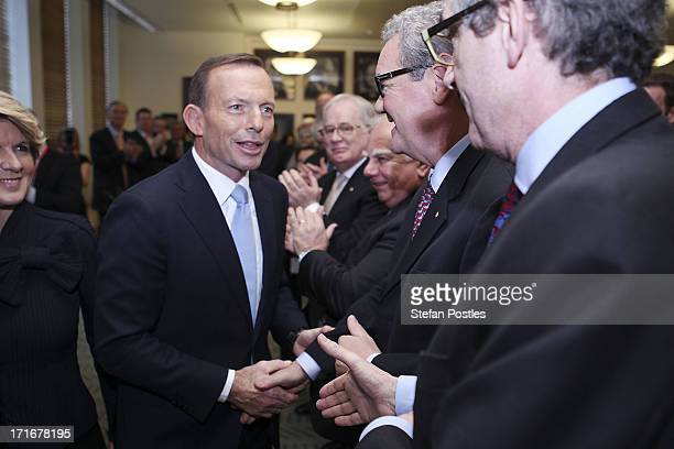 Opposition Leader Tony Abbott shakes hands with members of his party after his speech to Coalition MPs in the party room on June 28 2013 in Canberra...