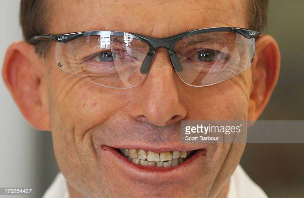 Opposition Leader Tony Abbott smiles while wearing safety glasses as he visits the Walter Eliza Hall Institue of Medical Research on July 11 2013 in...