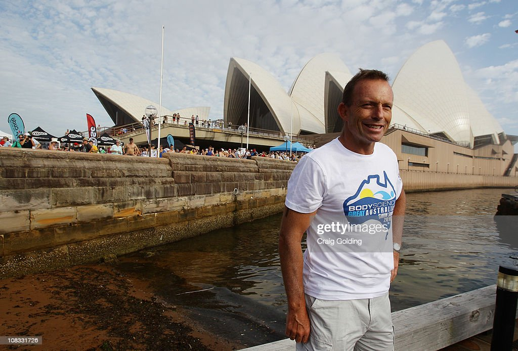 Opposition leader Tony Abbott talks with media before the start of the Body Science Great Australian Swim Series at the Sydney Harbour on January 26, 2011 in Sydney, Australia. The inaugural ocean swim event brings people of all ages together to compete in distances between 300 metres and 2.5 kilometres against the backdrop of the Sydney Harbour.