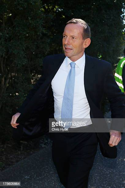 Opposition leader Tony Abbott walks to his car after a visit to JBS on August 5 2013 in Brisbane Australia Liberal party leader Tony Abbott is today...