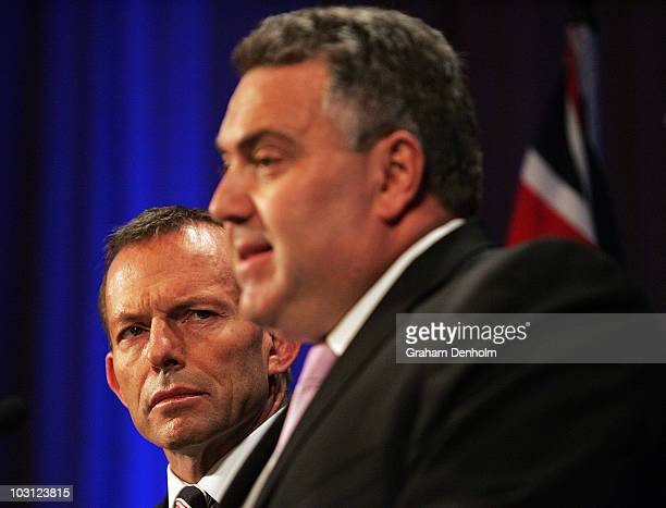 Opposition Leader Tony Abbott watches Shadow Treasurer Joe Hockey during a joint press conference at the Intercontinental Hotel on July 28 2010 in...