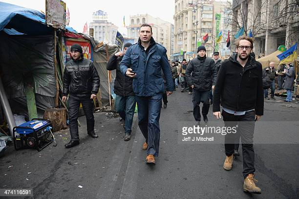 Opposition leader Vitali Klitschko arrives to address antigovernment demonstrators who remain in Independence square February 22 2014 in Kiev Ukraine...