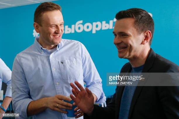 Opposition leaders Alexei Navalny and Ilya Yashin along with Navalny's supporters election observers monitor the voting at the office of his...