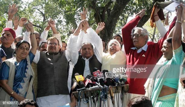 Opposition leaders Sushma Swaraj, Sharad Yadav, Mulayam Singh Yadav, Lalu Prasad Yadav and Gurdas Dasgupta talk to the media after they walked out of...