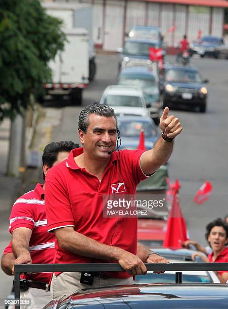 Opposition Libertarian Movement presidential candidate Otto Guevara gives the thumb up on January 31 in Poas de Alajuela 30 kilometers northwest of...