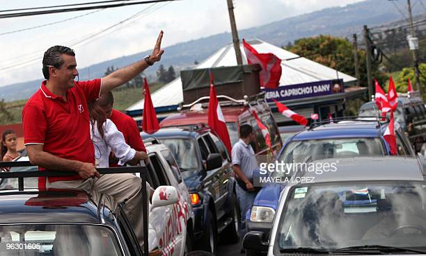 Opposition Libertarian Movement presidential candidate Otto Guevara waves to supporters on January 31 in Alajuela 22 kilometers northwest of San Jose...