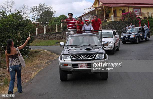 Opposition Libertarian Movement presidential candidate Otto Guevara gives the thumb up to a supporter on January 31 in Poas de Alajuela 35 kilometers...