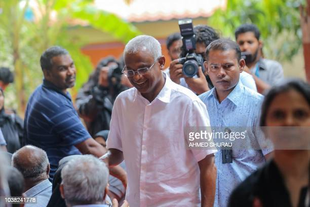 Opposition Maldives candidate for president Ibrahim Mohamed Solih arrives at a polling station to vote in the capital Male on September 23 2018...