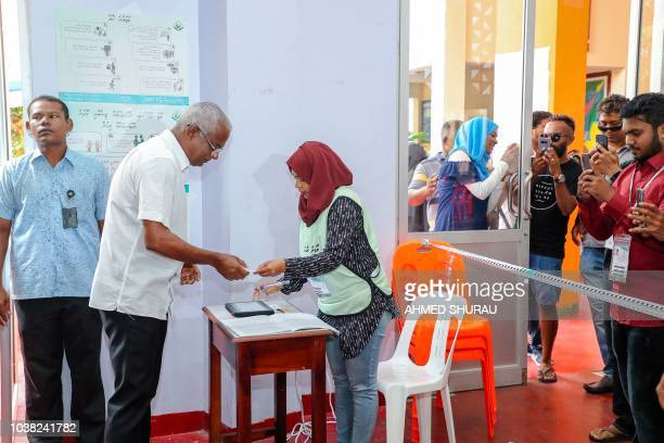 Opposition Maldives candidate for president Ibrahim Mohamed Solih votes at a polling station in the capital Male on September 23 2018 Voting began in...