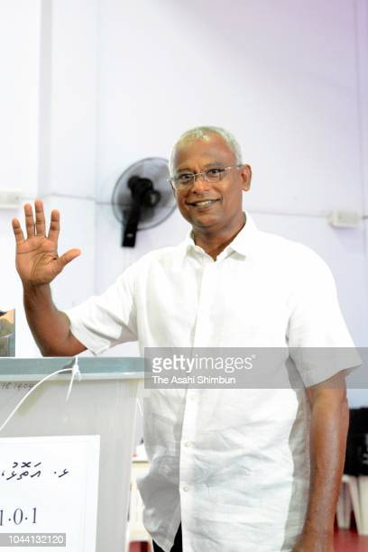 Opposition Maldivian Democratic Party presidential candidate Ibrahim Mohamed Solih waves after casting his ballot in the presidential election at a...