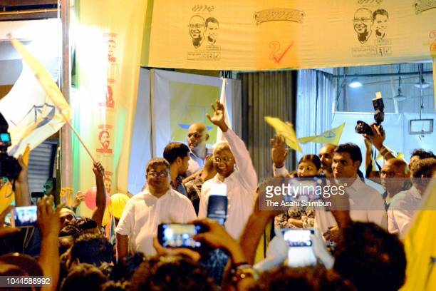 Opposition Maldivian Democratic Party presidential candidate Ibrahim Mohamed Solih waves to his supporters as he declares the victory on September 24...