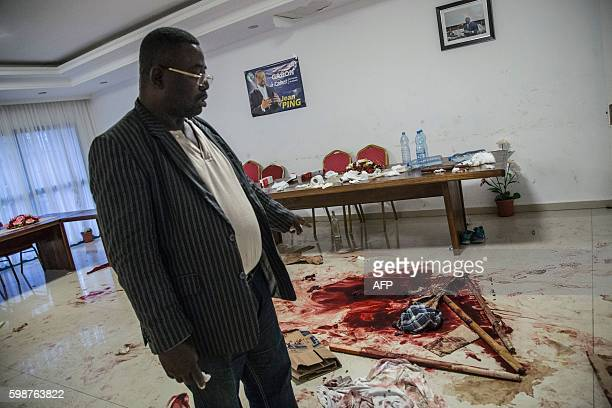 TOPSHOT Opposition member Filbert Mayombo shows traces of blood and destruction on September 2 2016 at the headquarters of the Gabonese opposition...