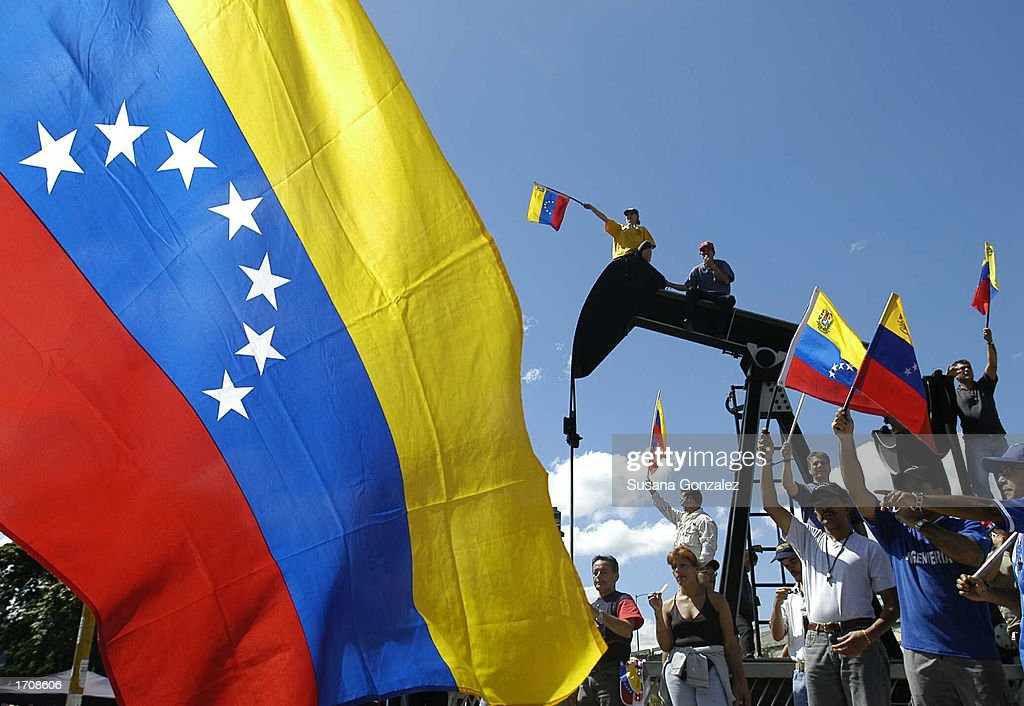 Opposition Members Carry Venezuelan Flags As They March : News Photo