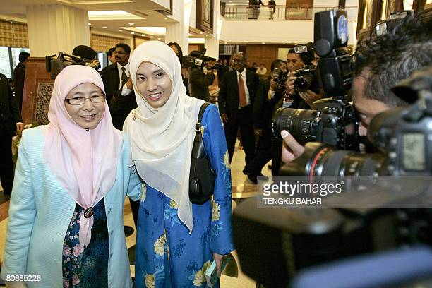 Opposition Parti Keadilan Rakyat president Wan Azizah Ismail who is the wife of former deputy prime minister Anwar Ibrahim poses for photographs with...
