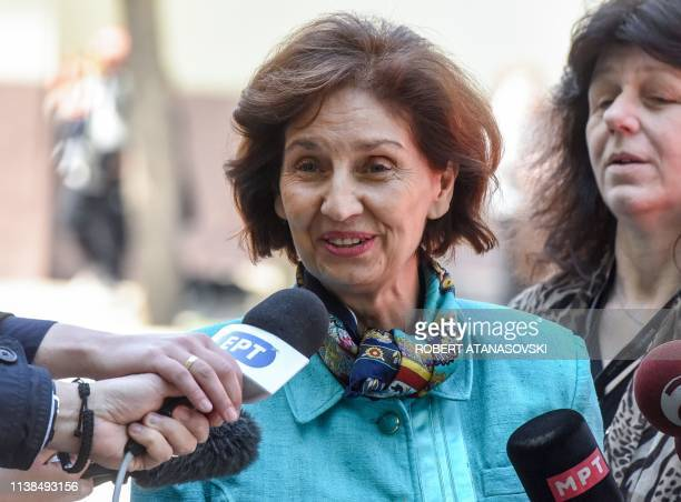 Opposition party candidate Gordana Siljanovska talks to the press after casting her vote for the presidential election in Skopje on April 21, 2019. -...