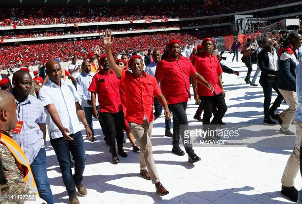 Opposition party Economic Freedom Fighters leader Julius Malema greets his supporters as he arrives for EFF final election rally at Orlando Stadium...