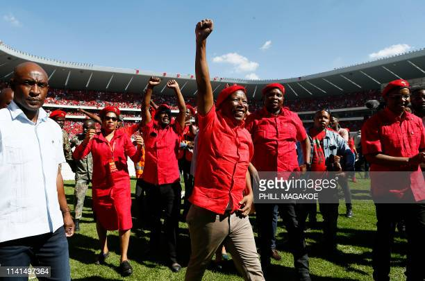 Opposition party Economic Freedom Fighters leader Julius Malema raises his fist as he arrives for EFF final election rally at Orlando Stadium in...