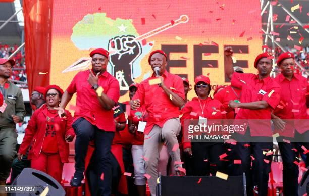 Opposition party Economic Freedom Fighters leader Julius Malema sing and dance on stage with members of his leadership during EFF final election...