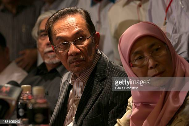 Opposition party leader Anwar Ibrahim speaks to the media along side his wife Dr Wan Nur Azizah during a late evening press conference concerning the...