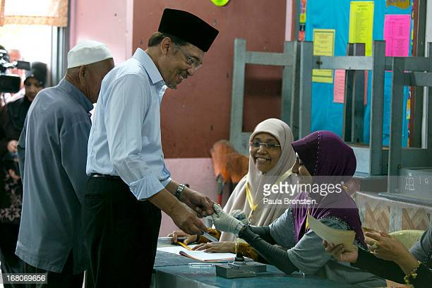 Opposition party leader Anwar Ibrahim votes May 5 2013 in Penanti Malaysia Millions of Malaysians cast their vote on Sunday in one of the most...