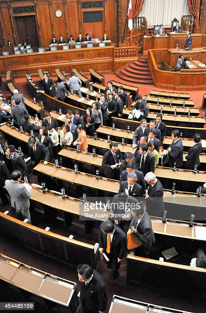 Opposition party members of the Upper House leave their seats to boycot to vote the state secrets protection bill at the diet building on December 6...