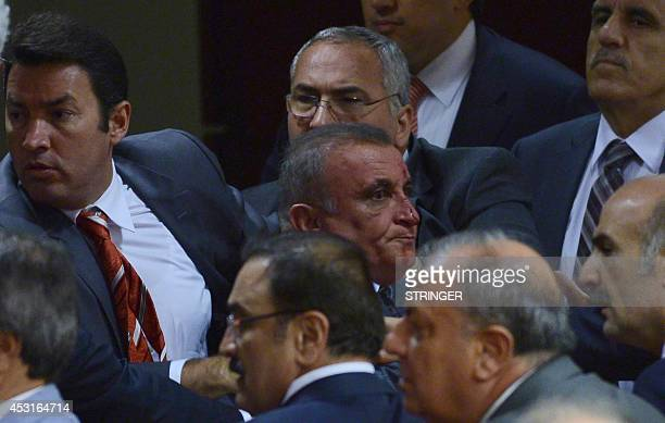 Opposition party MHP's deputy Ali Uzunirmak reacts after fighting with a deputy of the AKP ruling party at the parliament in Ankara on August 4 2014...