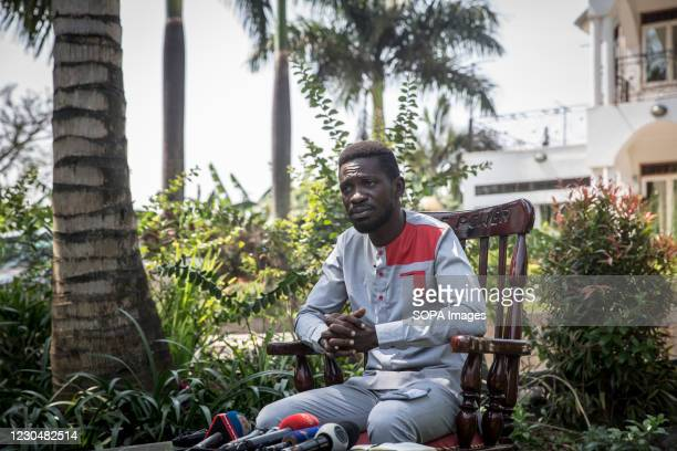 Opposition presidential candidate Bobi Wine, whose real name is Robert Kyagulanyi speaks during a press conference where he announced a petition to...