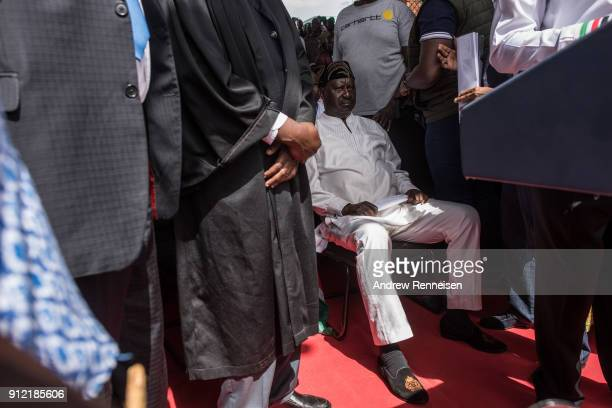 Opposition presidential candidate Raila Odinga sits prior to taking an oath as president during a mock 'swearingin' ceremony on January 30 2018 at...