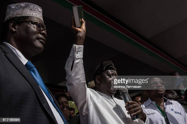 Opposition presidential candidate Raila Odinga takes an oath as president during a mock 'swearingin' ceremony on January 30 2018 at Uhuru Park in...