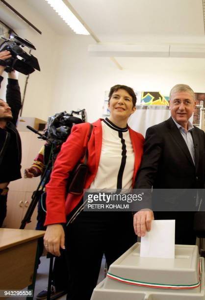 Opposition prime minister candidate Ferenc Gyurcsany of the 'Democratic Coalition' and his wife Klara Dobrev cast their ballots in a polling station...