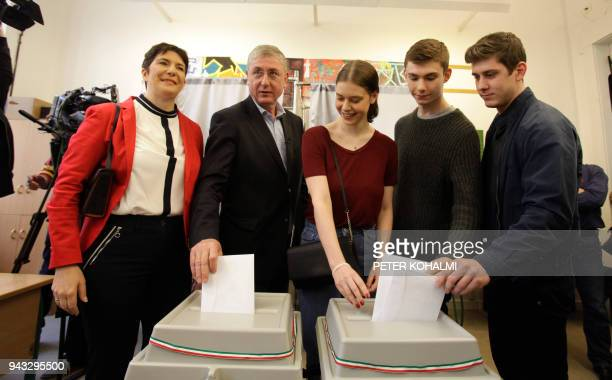 Opposition prime minister candidate Ferenc Gyurcsany of the 'Democratic Coalition' his wife Klara Dobrev and their family cast their ballots in a...